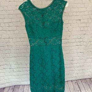 Lace teal dress with sheer panels